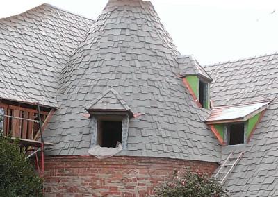 Former cedar shake roof replaced with Greenstone genuine slate
