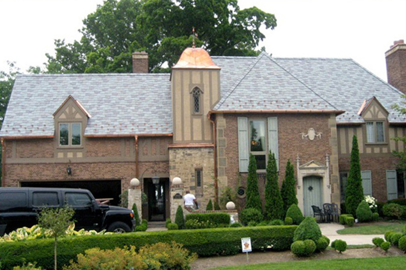 Traditional slate roof with copper accents vermont slate for Roof accents