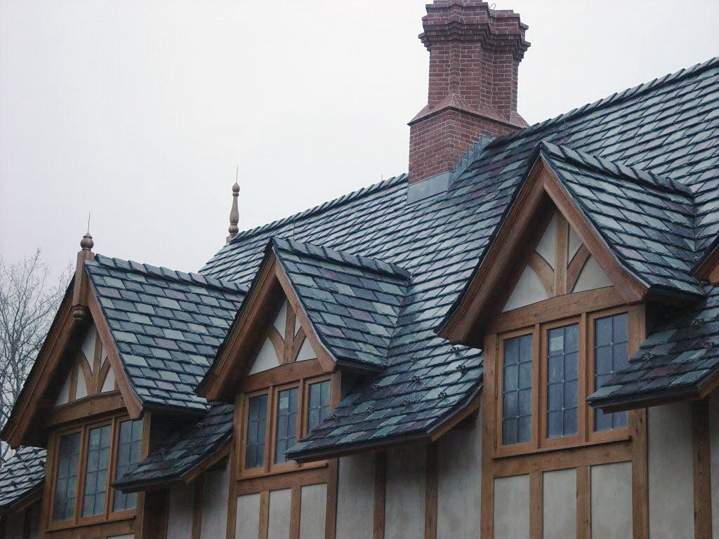 Gray green and purple slate blend on tudor style home for Tudor siding panels