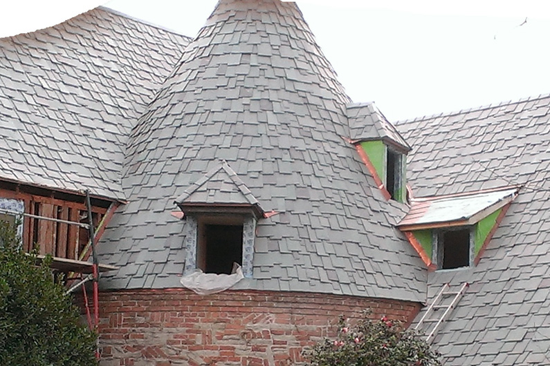 Former Cedar Shake Roof replaced with genuine vermont roofing slate