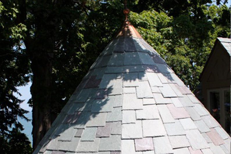 Slate roof turret with copper cap.