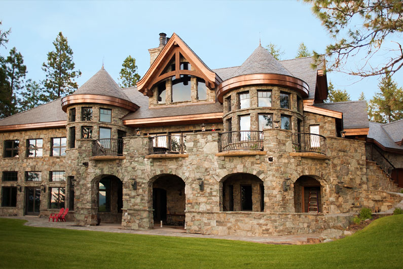 Slate and stone estate with slate turrets and copper detailing.