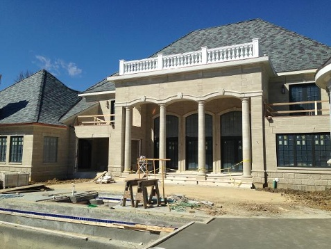 Who's building the mansion along Turkeyfoot Road?
