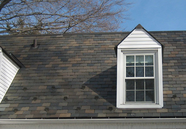 White brick home with Vermont Clear Black slate