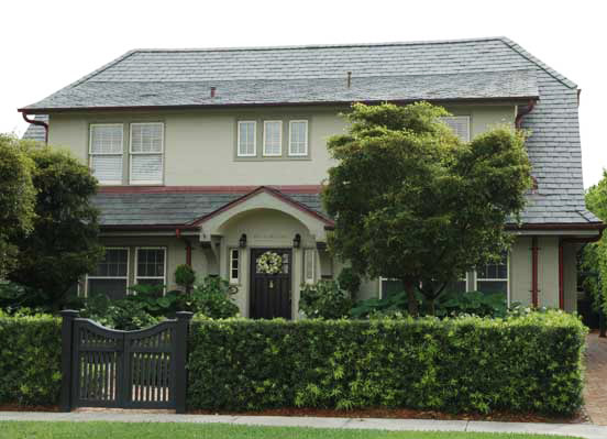 Stucco home with slate roof.