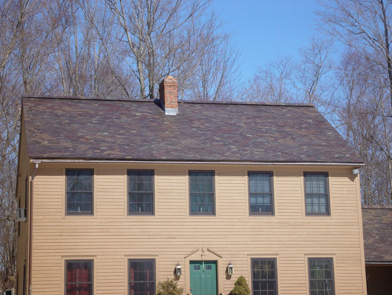 Vermont colonial style home with slate roof.