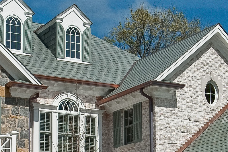 Close up of Non-weathering Gray / Green Slate Roof on Colonial Style New Construction