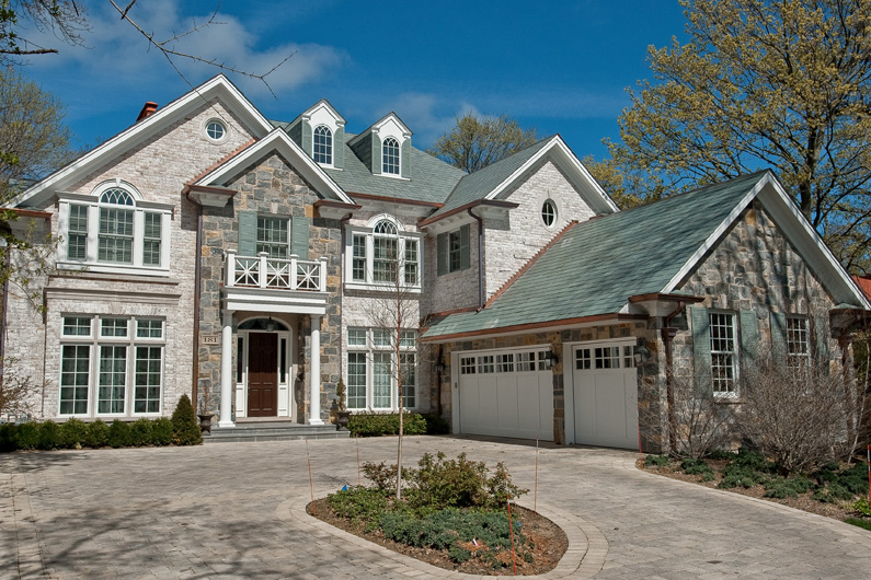 Front of Non-weathering Gray / Green Slate Roof on Colonial Style New Construction