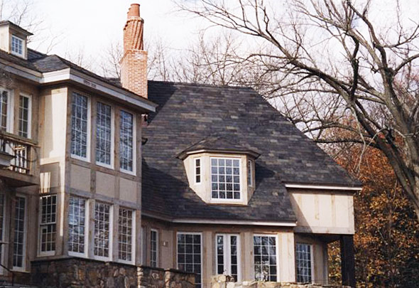 Vermont Clear Black slate on stone and stucco residence