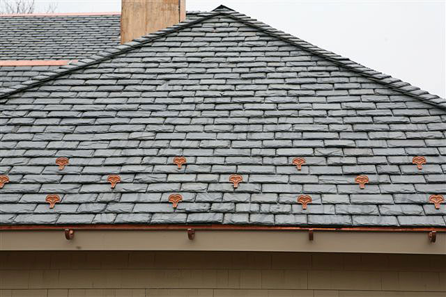 Slate roof with copper accessories