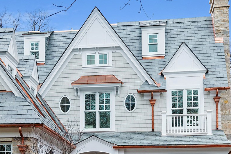 Coastal Nantucket style home with slate roof - Close up of slate roof with copper accessories