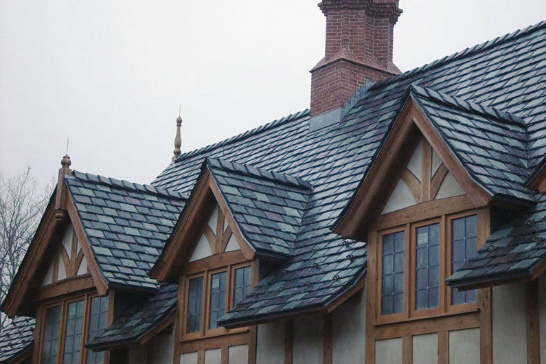 Gray, Green, and Purple Slate Blend on Tudor Style Home