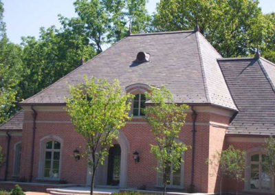 Slate Roof on Brick Home with Stone Archway