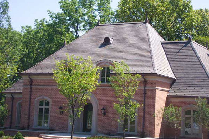 Slate Roof with blend of Royal Purple and Clear Black slate on Brick Home with Stone Archway