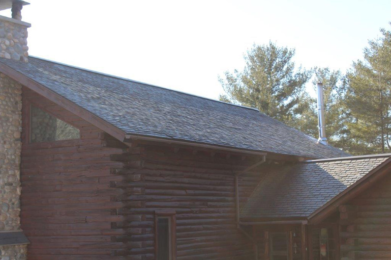 Log home with natural slate roof