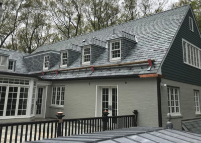 Graduated, random width slate roof and slate cladding for New Jersey residence