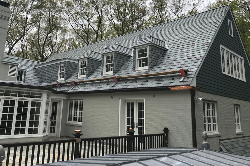 Vermont slate roof in gray greens and purple. Slate also installed as siding for dormers.