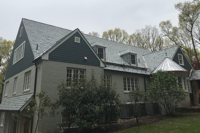 Genuine Vermont slate roof with slate siding on dormers