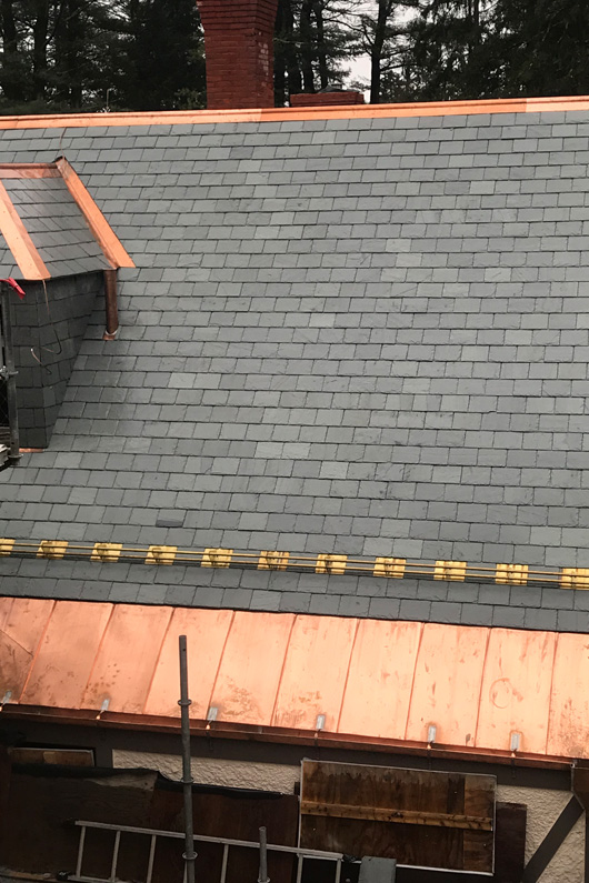 Greenstone Vermont slate and copper detailing.