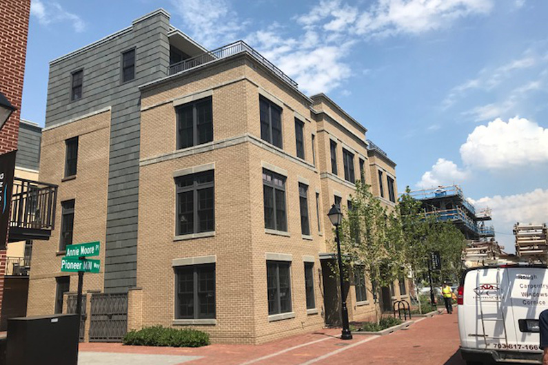 Project Profile: Slate cladding for luxury condominium complex. Greenstone Slate® Vermont Clear Gray installed using Nu-lok™ slate installation system